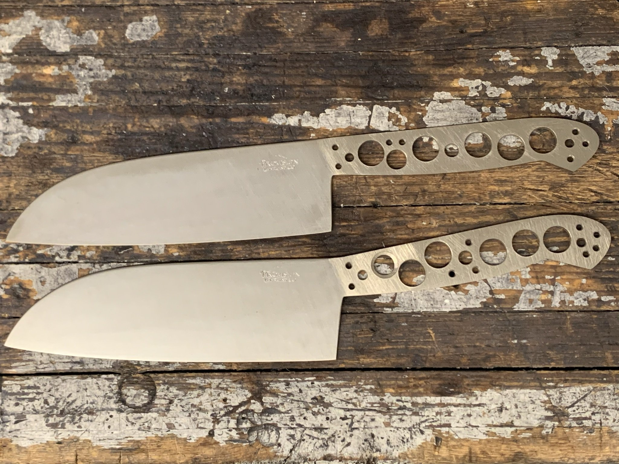 up close image of knives laying on table