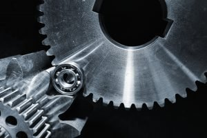 close up of gears on cogs