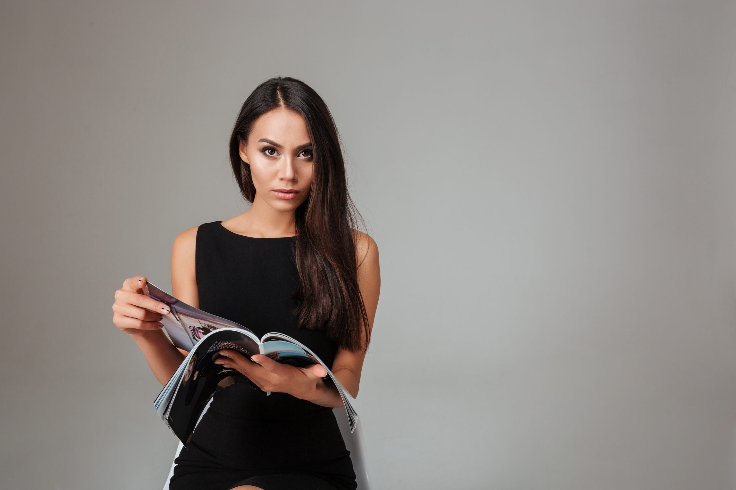 Image of person reading a featured magazine